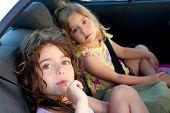 little girls inside car eating candy stick selective focus