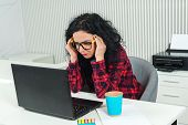 Tired Business Woman At Workplace. Stressed Woman Working On Laptop In Modern Office. Woman Holding  poster