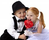 young lovers sharing a lollipop