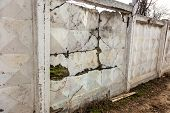 A Large Crack In The Old Stone Wall. Background Of A Stone Brick Wall Of A Building With A Deep Thro poster