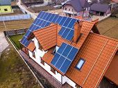 Aerial Top View Of New Modern Residential House Cottage With Blue Shiny Solar Photo Voltaic Panels S poster