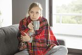 Desperate Girl Catching Cold And Staying At Home. Wrapped In Blanket Young Woman Drinking Hot Tea In poster