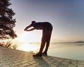Tired Runner On Trail Take Short Break For Deep Breathing.  Sportsman While Break After Morning Effi poster