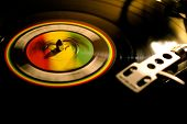 stock photo of rastafari  - A spinning record with the three african colors - JPG