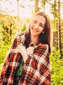 Outdoors Portrait Of Beautiful Smiling Brunette Girl Backlit. Beautiful Caucasian Brunette Girl Wrap poster
