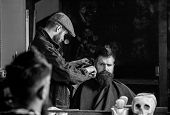 Hipster Client Getting Haircut. Haircut Concept. Barber Styling Hair Of Brutal Bearded Client With C poster