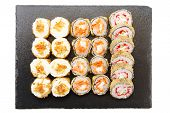 Delicious Sushi Rolls, Nigiri And Salmon Sushi Rolls. Sushi Isolated On Shale Food Board On White Ba poster