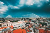 Riga, Latvia. Rainbow Over Cityscape. Building Of Latvian Academy Of Sciences, Built On Model Of Mos poster