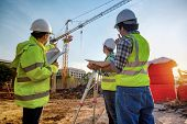 Construction Engineers Discussion With Architects At Construction Site Or Building Site Of Highrise  poster