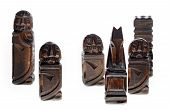 Few Wooden Carved Chess Pieces On White Background