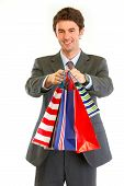 Portrait Of Smiling Modern Businessman With Shopping Bags