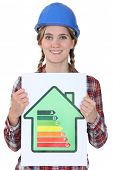 Woman with energy efficiency chart