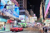 HONG KONG, CHINA - APR 23: Crowded street view at night on April 23, 2012 in Hong Kong, China. With