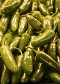 picture of chipotle chili  - Many green jalapeno peppers at a market - JPG