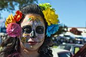 OCEANSIDE, CALIFORNIA - OCTOBER 28: An unnamed woman with a painted face at the Dia De Los Muertos