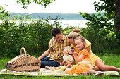 Happy family picnicking outdoors