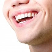 stock photo of human neck  - Beautiful wide smile of young man with great healthy white teeth - JPG