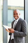 happy african american entrepreneur using tablet computer
