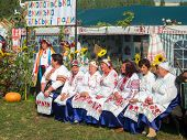 SUMY, UKRAINE - SEPTEMBER 22: Women wearing historical costume posing in traditional village backgro
