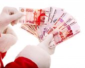 Santa Claus hand with  money Russian rouble. Isolated.