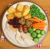 Roast turkey Christmas dinner with traditional trimmings.