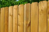stock photo of wooden fence  - Horizontal photo detail of a wooden fence constructed of unfinished pine - JPG