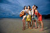 Asian Girls Friend Having Fun At The Beach