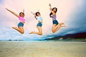 Group Of Happy Asian Woman Jumping Up High