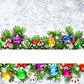 Christmas background with Christmas tree branches decorated with glass balls.