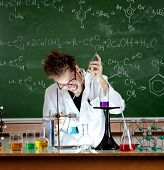 Mad professor holds an experiment in his laboratory