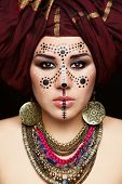 picture of turban  - Portrait of young beautiful woman with traditional Berber face paint and turban - JPG