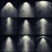 different types of lights on the brick wall