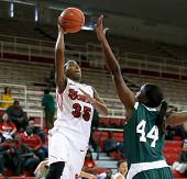 NEW YORK-NOV 3: St. John's Red Storm guard Shenneika Smith (35) shoots over Farmingdale Rams center
