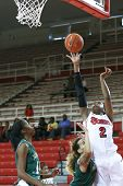 NEW YORK-NOV 3: St. John's Red Storm foward Amber Thompson shoots over Farmingdale Rams guard Nicky