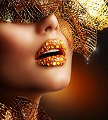 Luxury Golden Makeup. Beautiful Professional Holiday Make-up. Sexy Gold Lips.Fashion Art Portrait.Je