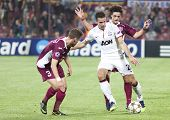 CLUJ-NAPOCA, ROMANIA - OCTOBER 2: Ivo Pinto, van Persie and Aguirregaray in UEFA Champions League ma