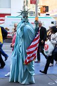 Artist Imitating Statue Of Liberty
