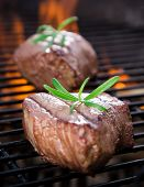 stock photo of braai  - closeup of a steak on grill - JPG