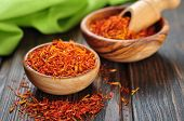 stock photo of saffron  - Saffron in wooden bowl on wooden background - JPG