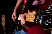stock photo of low-necked  - Man playing guitar in low key technique - JPG