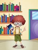 Illustration of a smiling boy holding a book in front of the bookshelves
