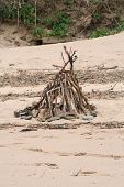 stock photo of tipi  - A small stick tipi on a beach