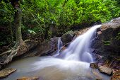 Small waterfall in tropical forest creek