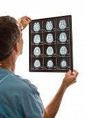 picture of mri  - Closeup of a doctor viewing MRI scans of brain against a white background - JPG