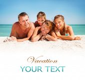 Happy Family Having Fun at the Beach. Joyful Family. Vacation and Travel concept. Summer Holidays. P