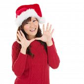 Happy Christmas woman excited say hello isolated on white background wearing red Santa hat. Beautiful Asian model.