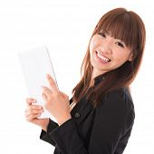 Portrait of happy Asian woman using a tablet pc isolated on white background. Asian female model.