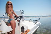 Beautiful woman driving a motor boat
