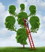 foto of psychologist  - Family therapy and group health care concept with a tree shaped as a group of human heads with a medical doctor psychologist or psychiatrist on a ladder fixing relationship problems - JPG
