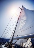 Sail of the yacht fluttering in the wind, summer adventure, sea cruise on sailboat, yachting sport, active lifestyle, holidays and vacation concept